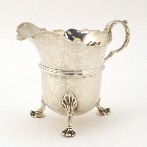 Stokes & Ireland, Edwardian silver cream jug, raised on three pad feet, Chester 1903, 8cm high, 91g