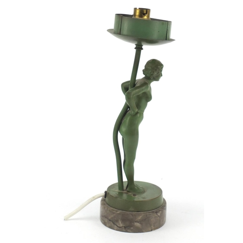 6 - Art Deco figural table lamp in the form of a nude female, raised on a grey marble base, 32cm high...