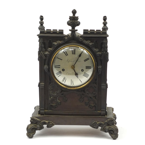 35 - 19th century cast iron Gothic bracket clock striking on a bell, with silvered dial and Roman numeral...
