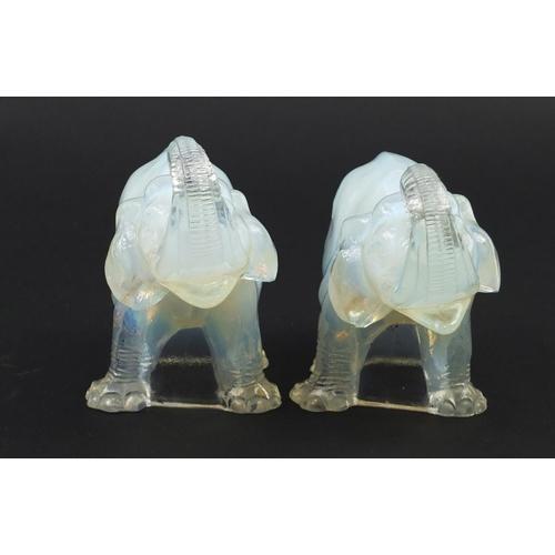 10 - Jobling, Pair of Art Deco opalescent glass elephants, registered number 795191, each 14.5cm in lengt...