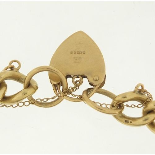 39 - 9ct gold bracelet with love heart padlock, 20cm in length, 38.0g...