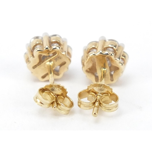 15 - Pair of 9ct gold diamond flower head earrings, approximately 1 carat in total, 1.5g...