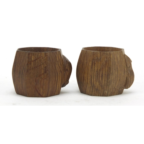 3 - Robert Mouseman Thompson pair of octagonal adzed oak napkin rings, each carved with a signature mous...