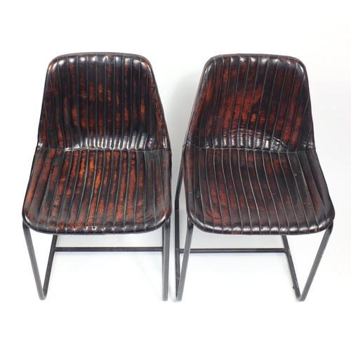 1395 - Pair of industrial chairs with brown upholstery, each 79cm high...