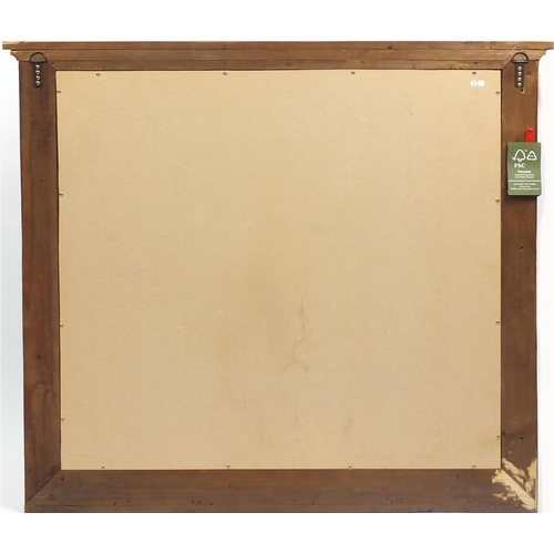 1397 - Large pine framed over mantle mirror with bevelled glass, 110cm x 127cm...