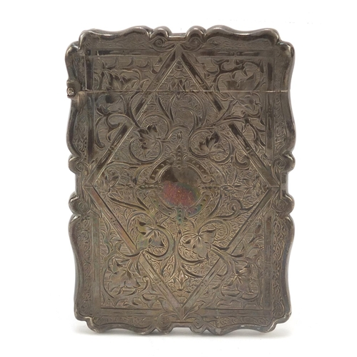 25 - Victorian silver card case engraved with flowers and vines, Birmingham 1871, 10cm high, 54.7g...
