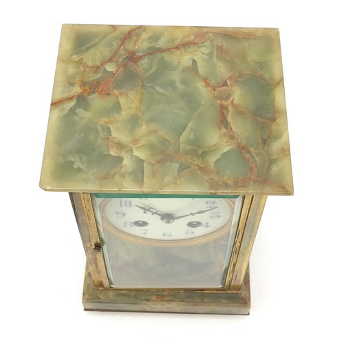36 - 19th century French onyx and brass four glass mantle clock striking on a gong, the enamelled dial wi...