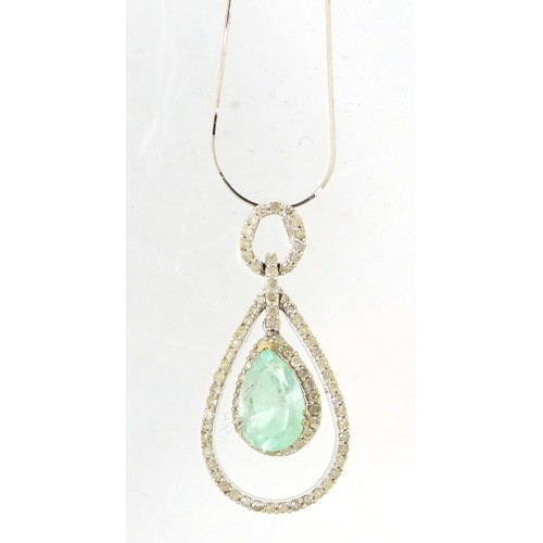 12 - 18ct white gold Columbian emerald and diamond surround pendant, 4cm in length on an 18ct white gold ...
