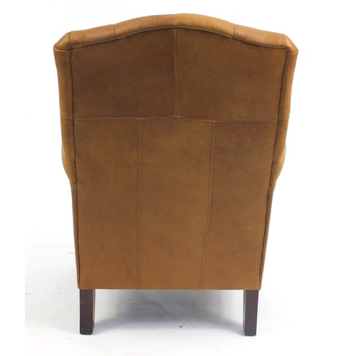 1332 - Brown leather club chair with tan button back upholstery, 100cm high...