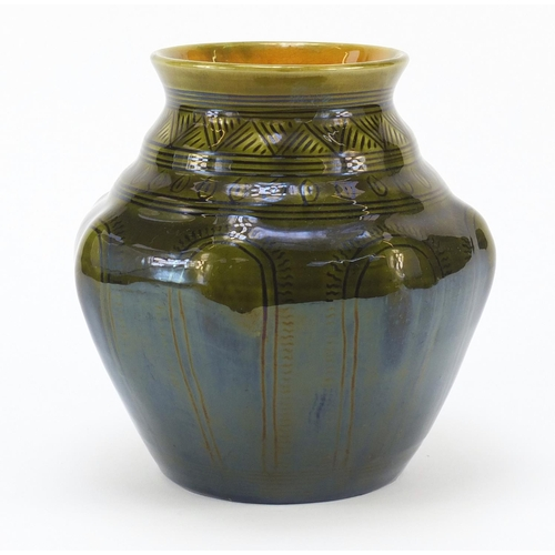 56 - Christopher Dresser for Linthorpe Pottery, Arts & Crafts pottery vase having a green glaze and incis...