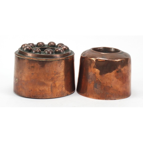 21 - Two 19th century copper jelly moulds, the largest 15cm in diameter...