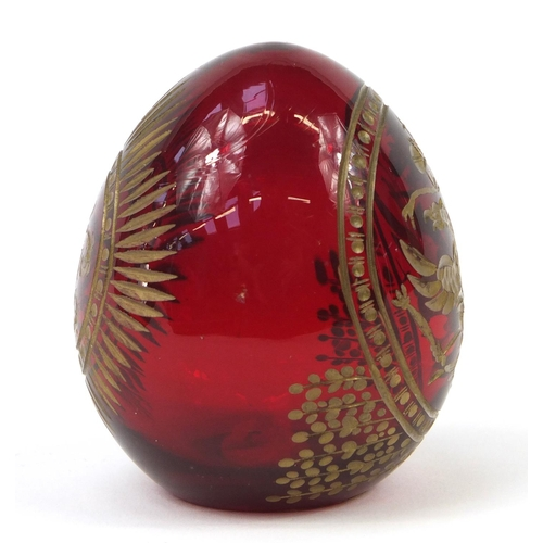 142 - Russian ruby glass egg in the style of Faberge, 6cm high...