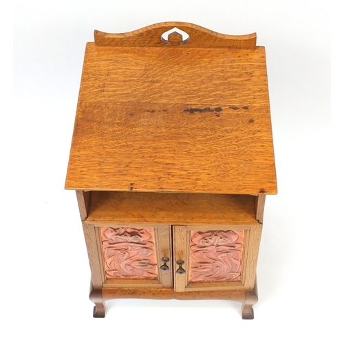 1466 - Liberty & Co style, Arts & crafts oak night stand having copper handles and doors embossed with styl...