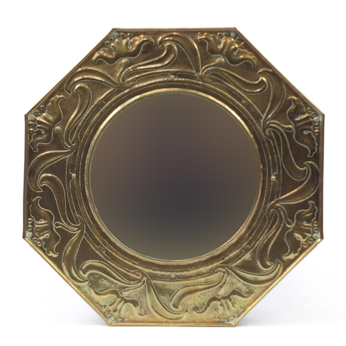12 - Keswick School of Industrial Arts, Arts & Crafts octagonal brass mirror embossed with stylised flowe...