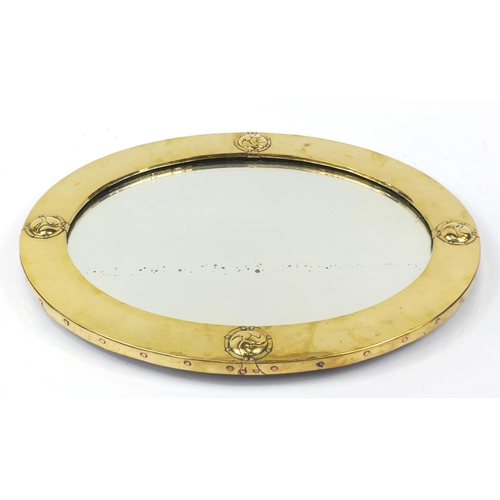 11 - Liberty & Co, Arts & Crafts planished brass and copper mirror with embossed roundels, Liberty London...