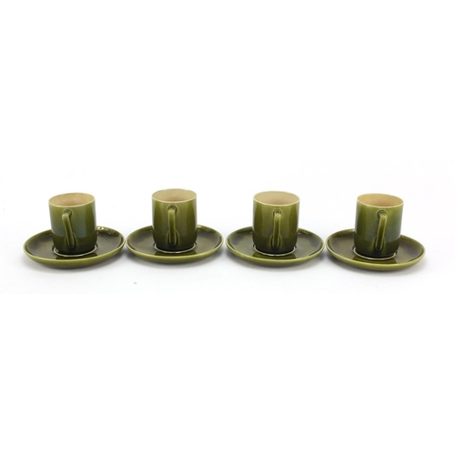 58 - Four Linthorpe Arts & Crafts pottery coffee cans and saucers having green glazes in the manner of Ch...