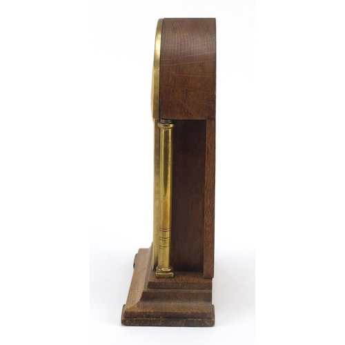 33 - Oak and brass Secessionist mantle clock with columns, 23cm high...