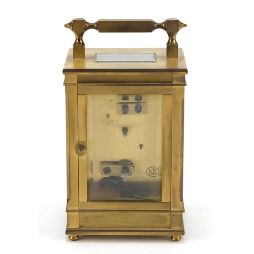 32 - Dent of London, brass cased carriage clock with bevelled glass and dial having Arabic numerals, 11.5...