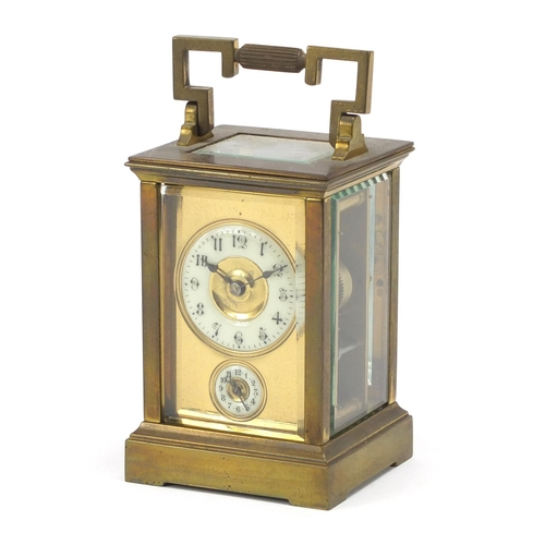 31 - 19th century brass cased carriage clock striking on a bell having enamelled and subsidiary dials wit...