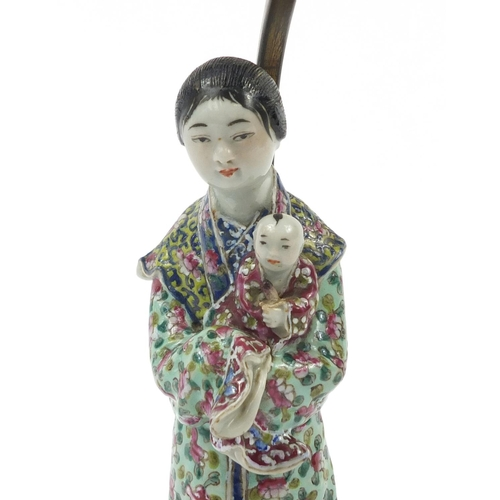 48 - Chinese porcelain table lamp with bronze mount, in the form of a mother holding a child, hand painte...