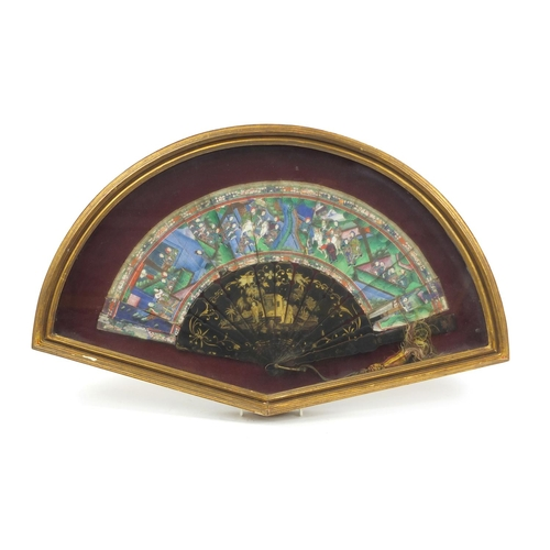 55 - Chinese brisé fan with black lacquered sticks and guards, hand painted and gilded with figures in pa...