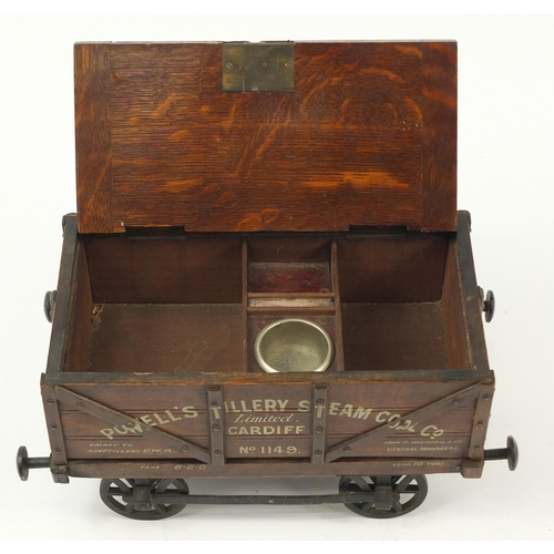 14 - 19th century railway interest advertising oak humidor in the form of a coal wagon, inscribed Powell'...