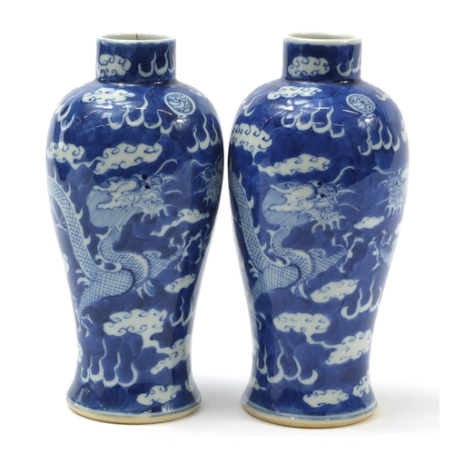 233 - Pair of Chinese blue and white porcelain baluster vases hand painted with dragons amongst clouds, fo...