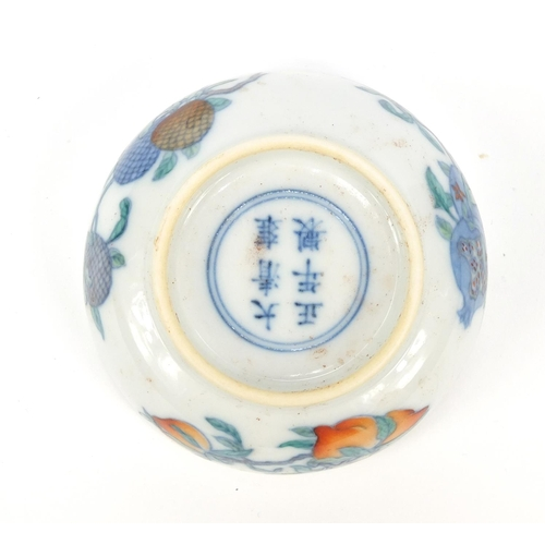 49 - Chinese doucai porcelain shallow dish hand painted with fruit, six figure character marks to the bas...