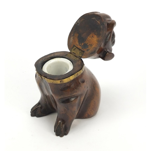 16 - Victorian carved treen Pug dog design inkwell with glass collar and ceramic liner, 11.5cm high