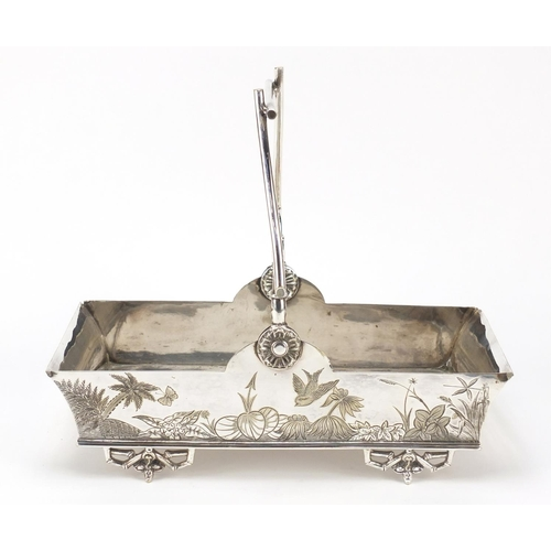 9 - Victorian aesthetic silver plated basket with naturalistic swing handle in the manner of Christopher...