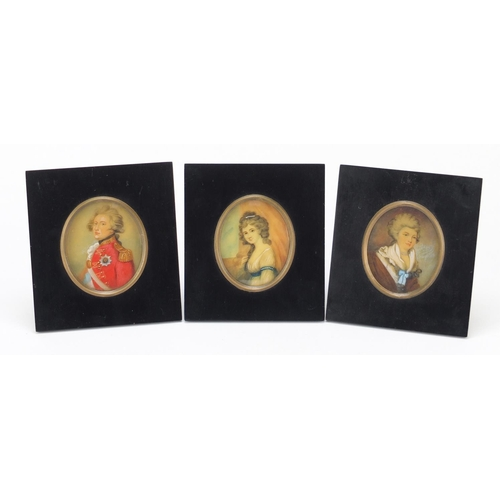 29 - Three oval hand painted portrait miniatures including one of a gentleman in naval dress, each housed...