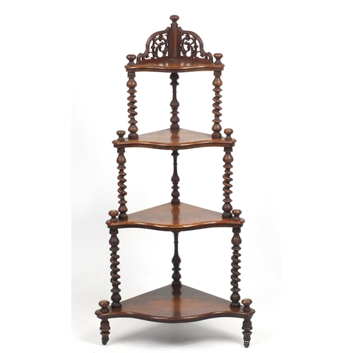Victorian walnut four tier whatnot with serpentine front, 137cm high