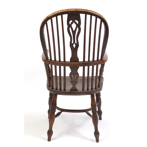 1555 - Victorian elm and yew Windsor chair with crinoline stretcher, 106cm high...