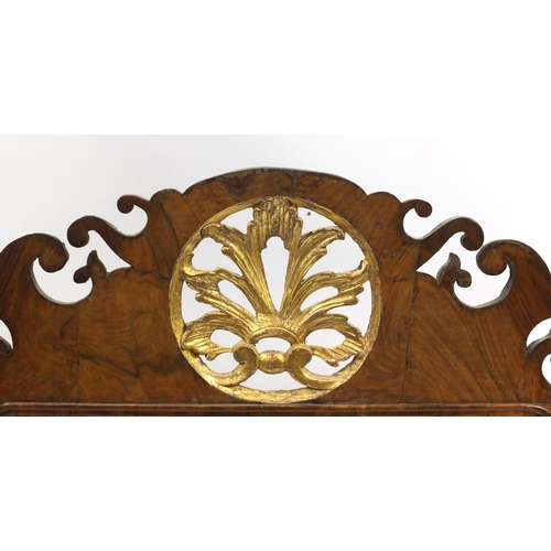 1467 - Georgian partially gilt walnut wall mirror with bevelled pate, carved with flowers, leaves and berri...
