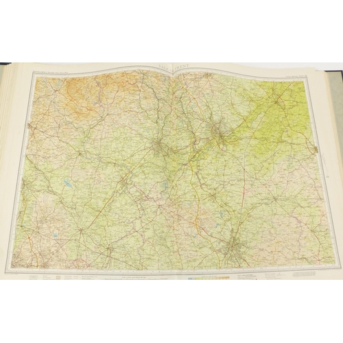1267 - Bartholomews revised half inch contoured maps with case, for library reference...