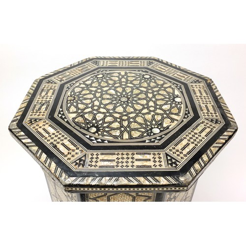 1514 - Syrian ebonised octagonal occasional table with mother of pearl geometric foliate inlay, 50cm high x...