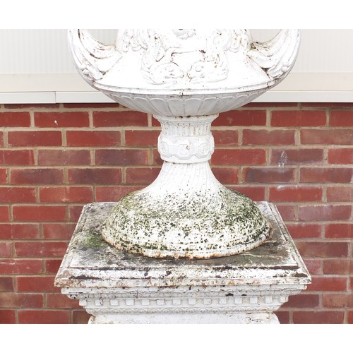 1468 - Very large cast iron Campana shaped urn and cover on stand with twin handles raised on square plinth...