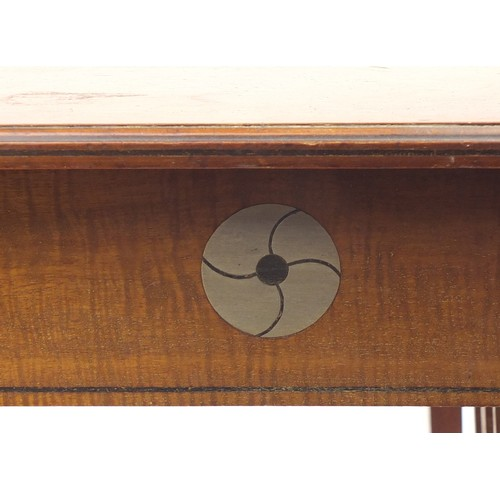 1464 - Leonard Wyburd for Liberty & Co, mahogany table with undertier inset with stylised pewter roundels, ...
