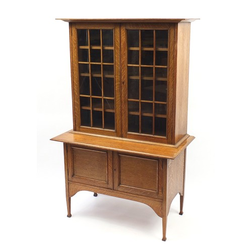 1465 - Liberty & Co style, Arts & Crafts oak glazed bookcase on stand with adjustable shelves, 169cm H x 10...