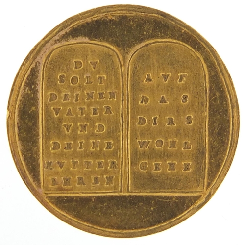 28 - Antique German gold medal with three trees in ornamental urns and two tombstones, 3.5g - this lot is...