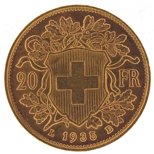 26 - Swiss 1935 gold twenty franc, 6.4g - this lot is sold without buyer's premium, the hammer price is t...