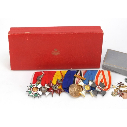 1356 - Foreign military interest medals and dress medals including Order of the Griffon with fitted case...