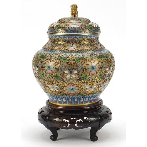 32 - Chinese cloisonné baluster vase and cover raised on carved hardwood stand, enamelled with flower hea...