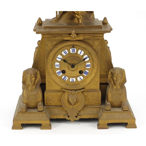 13 - French gilt metal Egyptian Revival mantle clock striking on a bell surmounted with a female and two ...