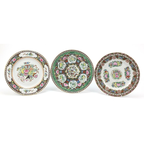 Three Chinese Canton plates hand painted with butterflies and flowers, each 27cm in diameter