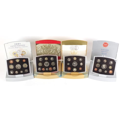 Four United Kingdom Executive proof coin collections comprising dates 2000, 2001, 2002 and 2003