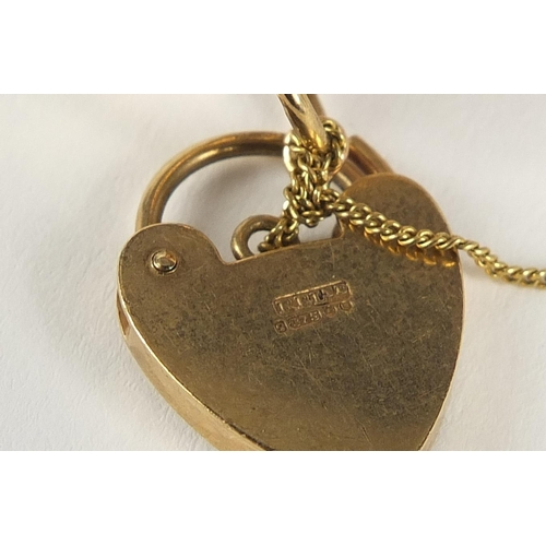 36 - 9ct gold eleven row gate bracelet with love heart shaped padlock, 18cm in length x 4cm wide, 31.5g...