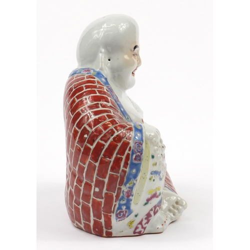 25 - Chinese porcelain figure of Buddha hand painted in the famille rose palette, 20cm high...