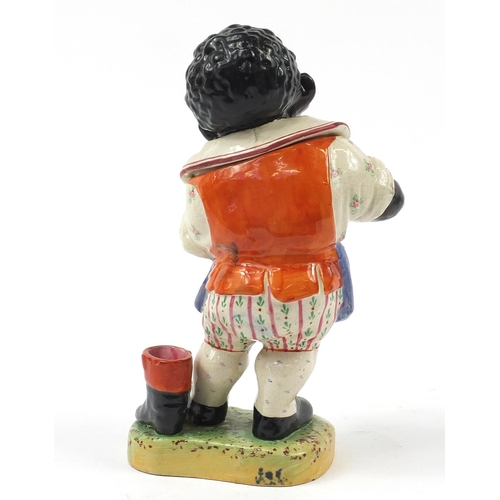 18 - Victorian Staffordshire tobacco jar and cover in the form of a standing black boy wearing an apron s...