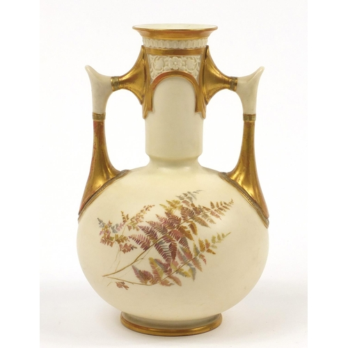 52 - Royal Worcester, Victorian blush ivory vase with twin handles decorated and gilded with flowers, num...